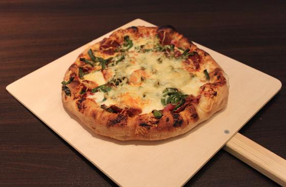 Qu'est ce que la cuisson au feu de bois apporte réellement à la préparation de vos pizzas?